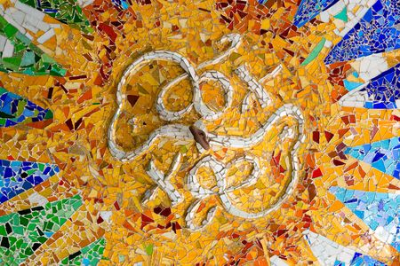Detail of a mosaic in ceiling in Antoni Gaudi Parc Guell, Barcelona, Spain