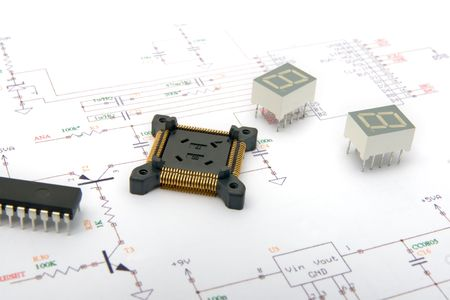 Electronic components on schematic drawings Stock Photo - 5837754