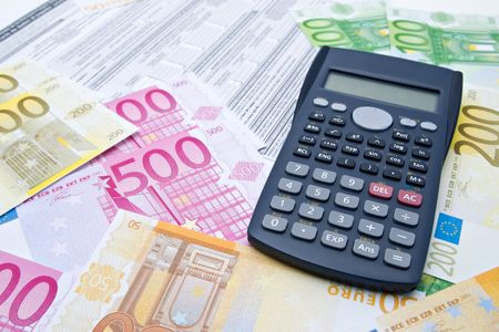 change purses: Euro banknotes and calculator Stock Photo