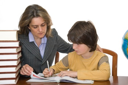 Mother teaching and helping her child with homework photo