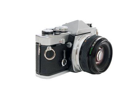 Old single lens reflex camera isolated on white background photo