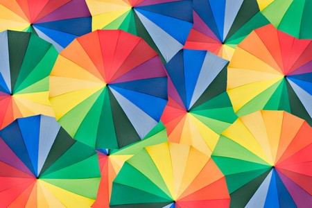 Umbrella with rainbow colors as background