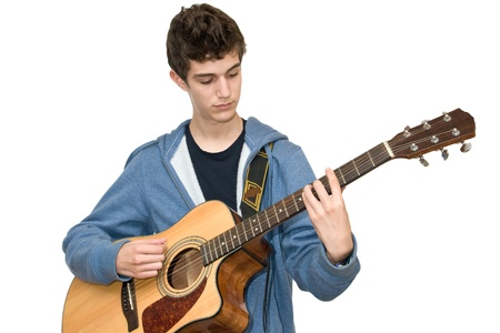 Teenager playing acoustic guitar on white background photo