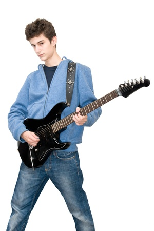 Teenager playing electric guitar on white background Stock Photo - 8245604