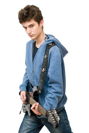 a guitarist boy playing guitar: Teenager playing electric guitar on white background