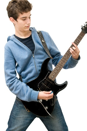 Teenager playing electric guitar on white background photo