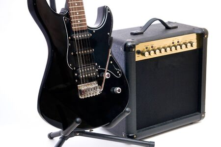 Electric guitar and amplifier isolated on a white background photo