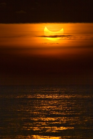 Catalonia - January 4: Partial solar eclipse during sunrise January 4, 2011 in Catalonia photo