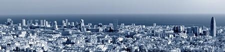 Barcelona skyline panorama, blue toned photo