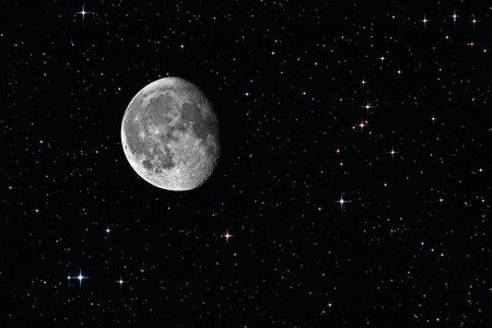Waning gibbous moon among the stars in the background Stock Photo - 9964398