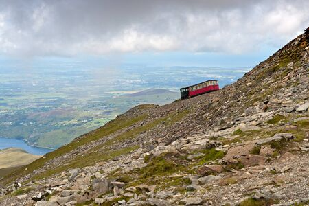railway engine: Steam Train heading to the Snowdon summit, Snowdonia, Wales Stock Photo