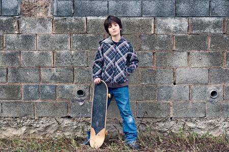 skateboarder: Kid in urban background Stock Photo