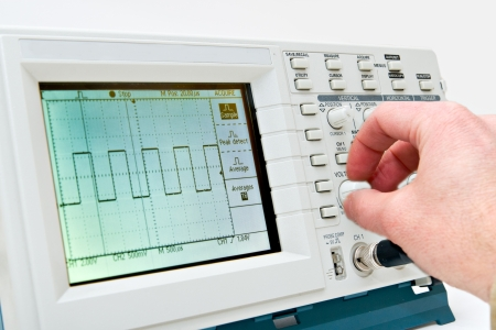 oscilloscope: Engineer Operating a Digital Oscilloscope