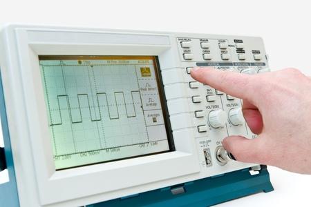 test equipment: Engineer Operating a Digital Oscilloscope