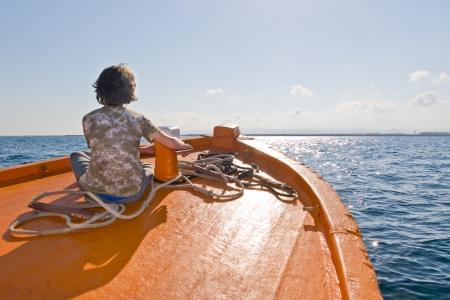 onboard: Kid sitting on a Pilot Boat