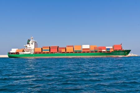 cargo vessel: Cargo Ship Leaving the Port