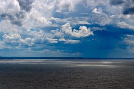 cumulus cloud: Dramatic storm clouds over the sea
