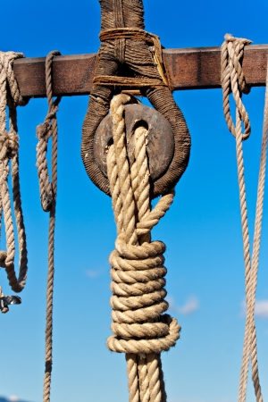 rigging: Ancient wooden sailboat deadeye and ropes detail