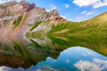 Reflections on the Asnos lake in Panticosa, Spanish Pyrenees photo