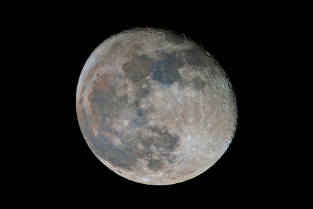 gibbous: Waning gibbous Moon showing subtle color differences due to the geological nature of its surface, captured with an amateur telescope