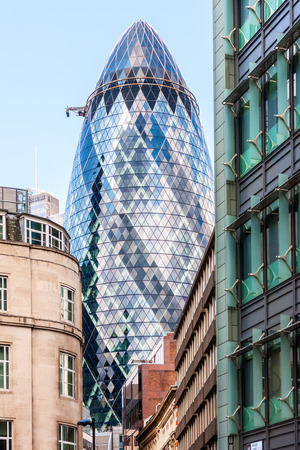 30 st mary axe: LONDON, UK - AUG 6: The Gherkin Tower (30 St Mary Axe) in the City of London on August 6, 2014.The skyscraper was designed by Norman Foster and Arup Group and it was erected by Skanska. Editorial