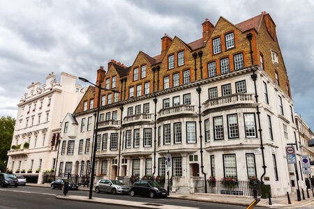 describe: LONDON -AUGUST 15:  The famous Chelsea district on August 15, 2014 in London. The exclusivity of Chelsea as a result of its high property prices has historically resulted in the term Sloane Ranger to be used to describe its residents