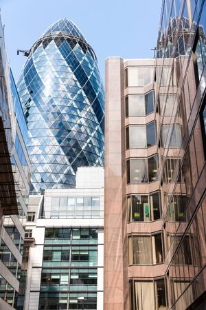 erected: LONDON, UK - AUG 6: The Gherkin Tower (30 St Mary Axe) in the City of London on August 6, 2014.The skyscraper was designed by Norman Foster and Arup Group and it was erected by Skanska. Editorial