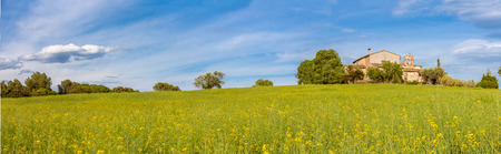catalonia: Catalan Farmhouse Panorama with spring fields in the foreground Stock Photo
