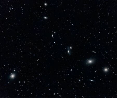 messier: Markarians Chain Galaxy Cluster in Virgo captured with an amateur telescope Stock Photo