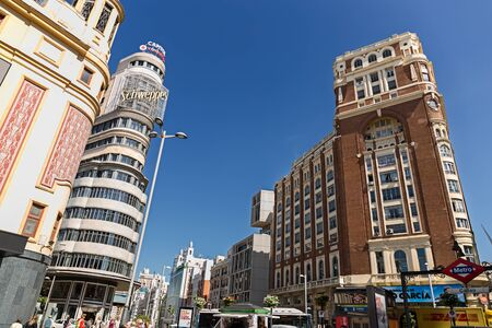 MADRID, SPAIN - JUNE 5, 2017: The 14-story Capitol building in Art-Deco style and the Press building at Gran Via Streeet in Madrid, Spain on June 5, 2017 Editorial