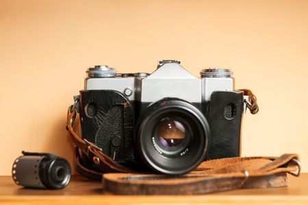 old photographs: Vintage Camera with old photographs and films on a wooden table