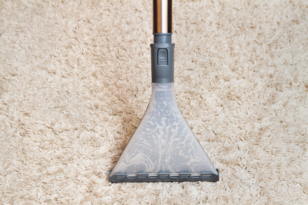 hoover: Cleaning carpet by washing hoover. View from above Stock Photo