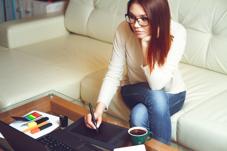 telework: Designer at work with a cup of coffee. Telework concept Stock Photo