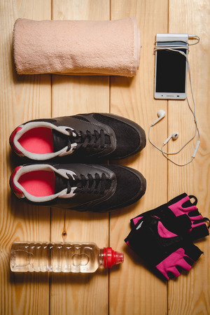 Sports equipment on the wooden floor. top view Stock Photo