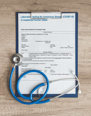 Doctors desk with the results of research or the number of new cases of COVID-19 in the world top view, stethoscope and patients medical record copy space