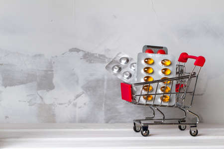 Many blisters with pills in a shopping trolley. Medical concept Stock Photo