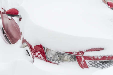 The Snow covered parked car in a snowdrift