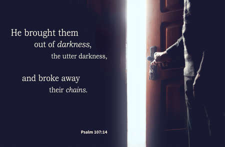 Christian bible verses psalm 107: 14, elderly senior in the darkness and light from an open door