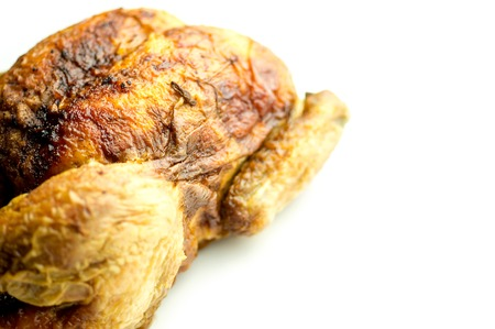 Side view of whole chicken on white background