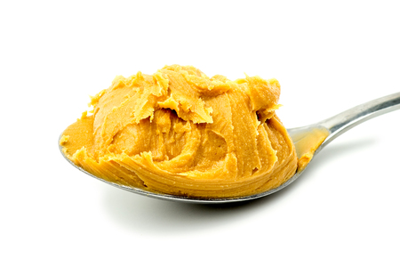 Macro spoon with yummy peanut-butter