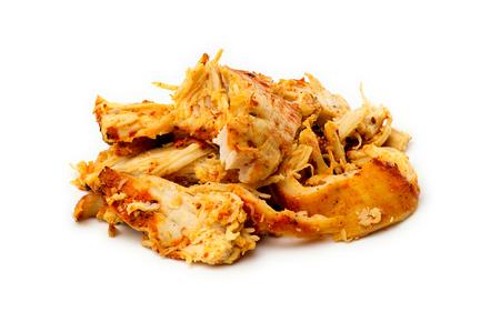 Macro closeup of juicy seasoned tandoori chicken isolated on white