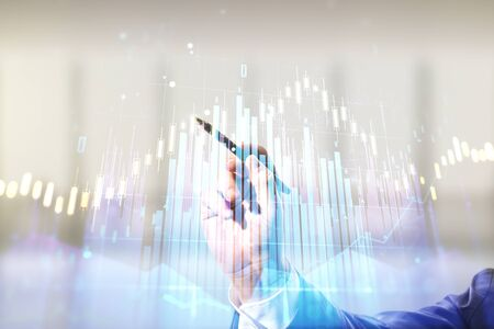 Multi exposure of analyst hand with pen working with virtual abstract financial diagram on blurred office background, banking and accounting concept