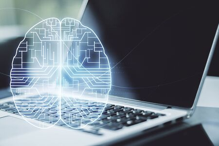 Creative artificial Intelligence concept with human brain hologram on modern laptop background. Multiexposure