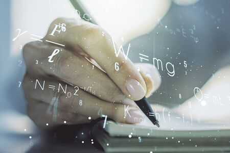 Creative scientific formula illustration with woman hand writing in diary on background, science and research concept. Multiexposure