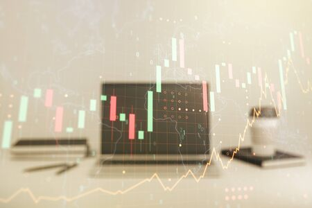 Multi exposure of abstract financial graph with world map on modern computer background, financial and trading concept