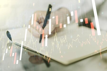 Multi exposure of abstract creative financial graph with world map and with man hand writing in notebook on background, forex and investment concept