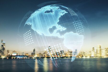 Digital map of North America hologram on Chicago cityscape background, global technology concept. Multiexposure