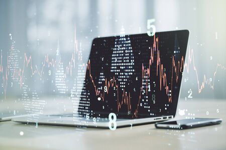 Abstract creative financial graph on modern laptop background, forex and investment concept. Multiexposure