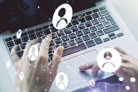 Double exposure of social network icons concept with hands typing on laptop on background. Marketing and promotion concept Stockfoto