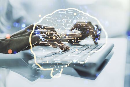Creative artificial Intelligence concept with human brain sketch and hands typing on computer keyboard on background. Double exposure